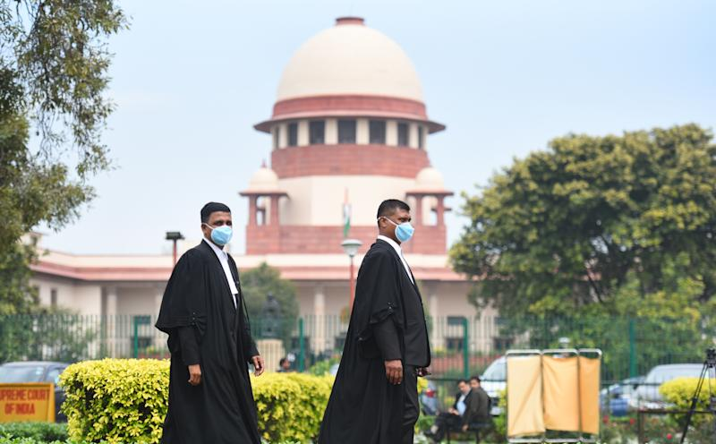 NEW DELHI, INDIA - MARCH 16: Advocates wearing protective masks as a precautionary measure amid rising coronavirus scare, at Supreme court on March 16, 2020 in New Delhi, India. (Photo by Raj K Raj/Hindustan Times via Getty Images)