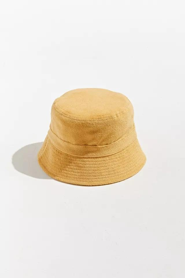 <p>Available in two neutral colors, this <span>UO Classic Terrycloth Bucket Hat</span> ($10, originally $19) is a simple and functional summer staple, especially if you're by the water. Hello, portable towel!</p>