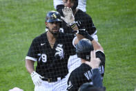 Chicago White Sox's Jose Abreu (79) high-fives Andrew Vaughn, right, after hitting a two-run home run during the fifth inning of the second baseball game of a doubleheader against the Baltimore Orioles, Saturday, May 29, 2021, in Chicago. (AP Photo/Matt Marton)