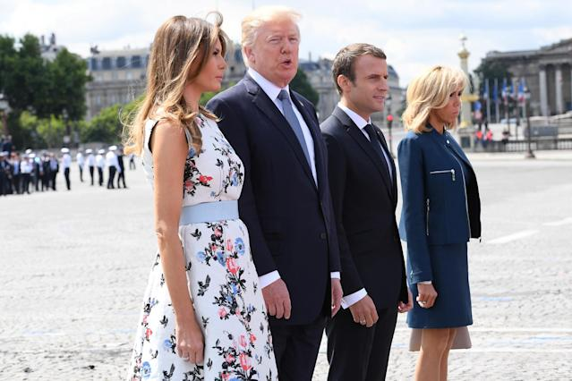 <p>French President Emmanuel Macron (R) and his wife Brigitte Macron (2nd R) stand with President Donald Trump and First Lady Melania Trump after the traditional Bastille Day military parade on the Champs-Elysees avenue in Paris, France, July 14, 2017. (Photo: Christophe Archambault/Pool/Reuters) </p>