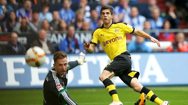 <p>Christian Pulisic of Borussia Dortmund watches as his shot flies past Ralf Faehrmann of FC Schalke 04 and wide of the post at Veltins-Arena on April 10, 2016 in Gelsenkirchen, Germany.</p>