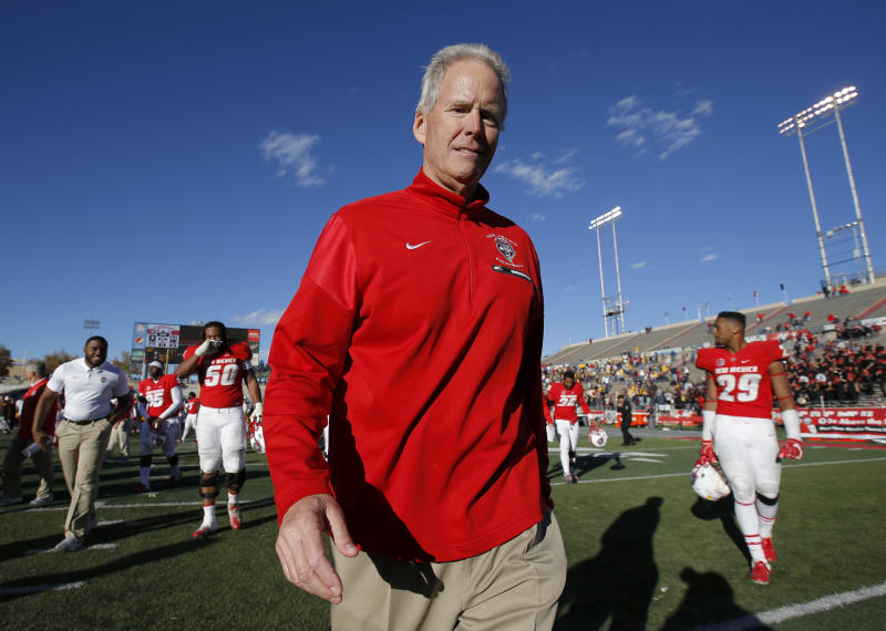 "FILE - In this Nov. 24, 2018, file photo, New Mexico coach Bob Davie walks off the field after the team's NCAA college football game against Wyoming in Albuquerque, N.M. New Mexico says Davie was taken to the hospital after what it called ""a serious medical incident,"" following the team's he team's game Saturday night, Aug. 31, against Sam Houston State. Athletic director Eddie Nunez released a statement after the Lobos won 39-31 at home in Albuquerque, New Mexico. Nunez said the university will release more information as it becomes available. (AP Photo/Andres Leighton, File)"