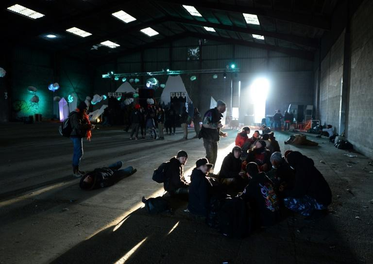People wait after an illegal New Year party in Rennes, France, that the police tried to break up