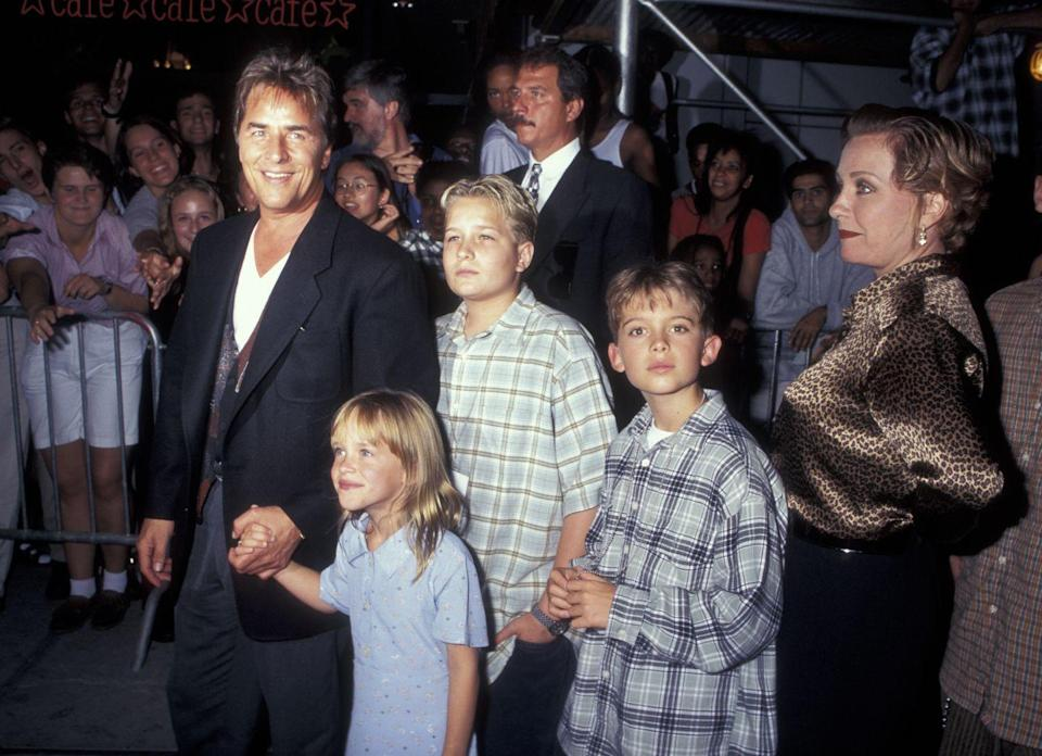 <p>Before her days of walking the red carpet solo as a movie star, Dakota Johnson joined her famous dad, Don Johnson (left), for the premiere of <em>Tin </em>at the age of seven.</p>