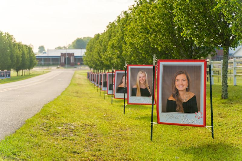 The principal of Poplar Springs High School in Graceville, Florida lined the school driveway with portraits of the graduating senior class. (Photo: Mattox Studios)