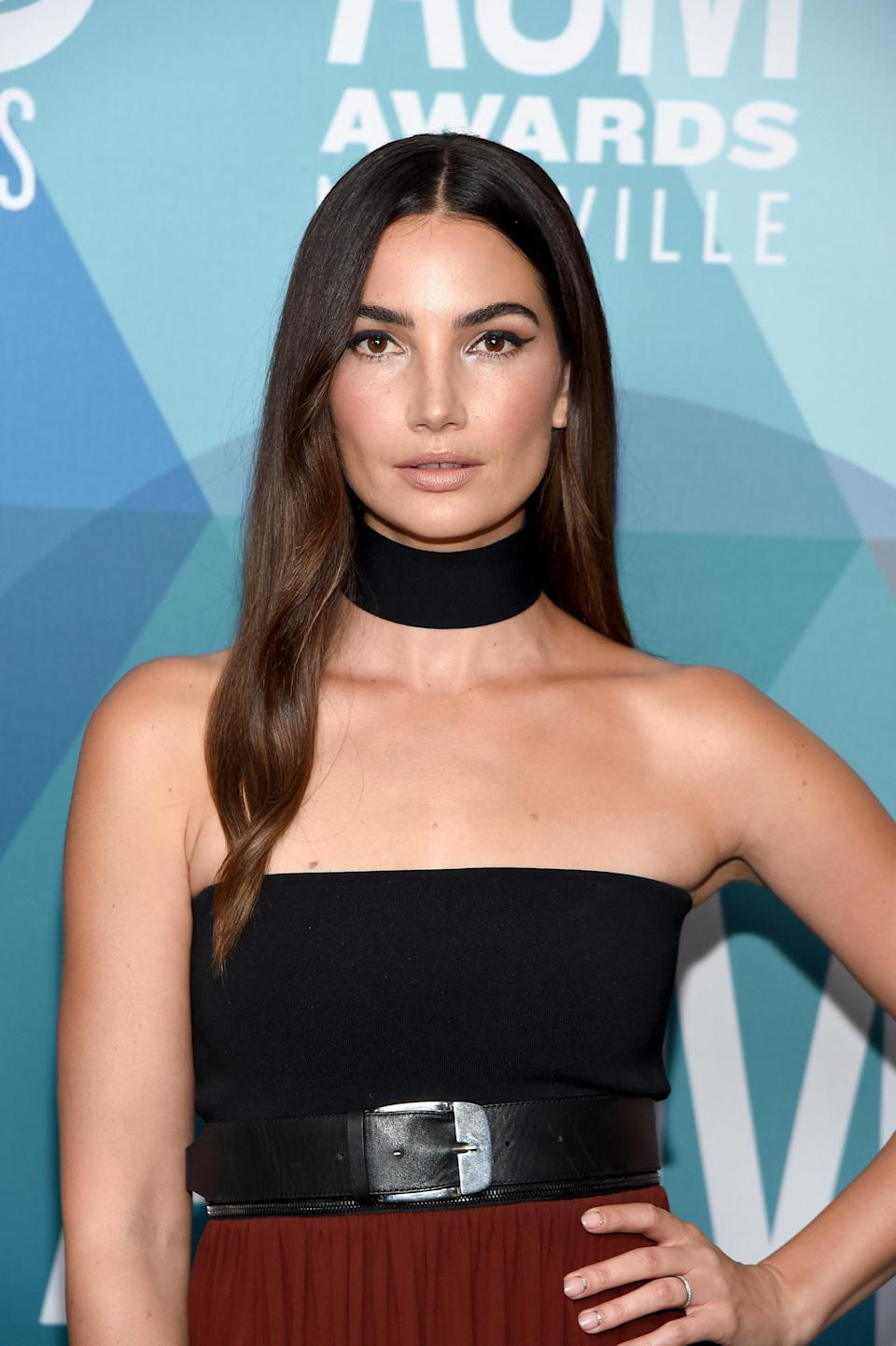"""<p>It's not just highlights that give Lily Aldridge her gorgeous, subtly dimensional brunette look. Cunningham says there's also """"a warm gloss all over making her hair feel very rich and healthy."""" She recommends asking your colorist for highlights with a dark gold all over. """"It's always better to bring in a photo because it's so difficult to describe hair color with words,"""" Cunningham advises. </p> <p>For an easy-to-use brunette gloss treatment you can use right in your own shower, try <a href=""""https://shop-links.co/1733981693807283137"""" rel=""""nofollow noopener"""" target=""""_blank"""" data-ylk=""""slk:Tresemmé Gloss Color-Depositing Hair Conditioner"""" class=""""link rapid-noclick-resp"""">Tresemmé Gloss Color-Depositing Hair Conditioner</a> in Dark Brunette.</p>"""
