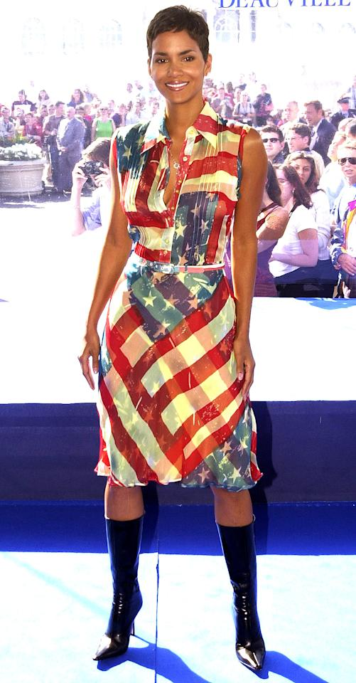 """The best part about this Catherine Malandrino Americana dress (which happens to be an <a rel=""""nofollow"""" href=""""http://people.com/style/see-the-most-popular-patriotic-dress-in-hollywood-hint-its-been-worn-by-meryl-streep-and-wendy-williams/"""">epic fashion faceoff</a>)? Halle decided to wear it to her film premiere in France in September 2001."""