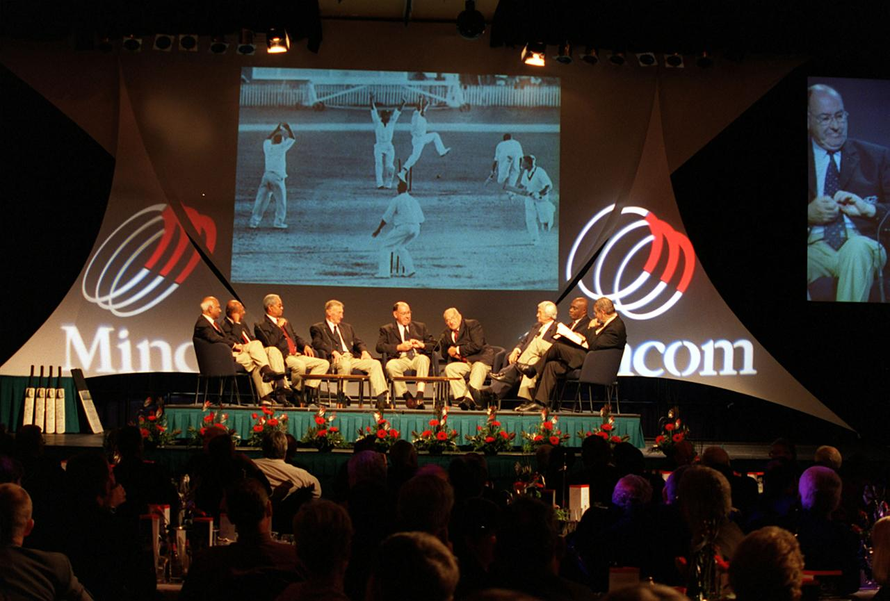 21 Nov 2000;  Left to right;  Rohan Kanhai (WI), Joe Solomon (WI), Sir Garfield Sobers (WI), Lindsay Kline (Aus), Ian Meckiff (Aus),  Gerry Alexander (WI), Richie Benaud (Aus), Wesley Hall (WI) and journalist Mike Coward sit in front of the famous Ron Lovett photograph as they  join other players from Australia and West Indies who played in the first ever tied Test match at The Gabba in 1960 along with the current players of Australia and West Indies for a fortieth anniversary reunion of the tied Test at the Brisbane Convention Centre ahead of the First  Test Match between Australia and the West Indies at The Gabba cricket ground, Brisbane, Australia. Mandatory Credit: Nick Wilson/ALLSPORT