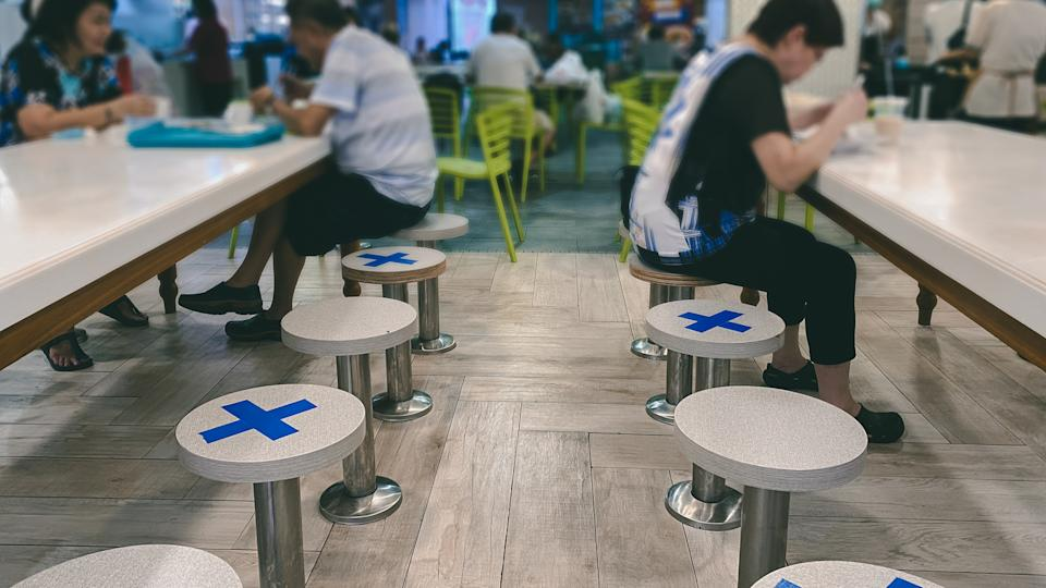 Singapore Mar2020 Social distancing rules in practice, alternate seating in local public food courts (restaurants, food outlets), to reduce risk of further transmission; safety measures.