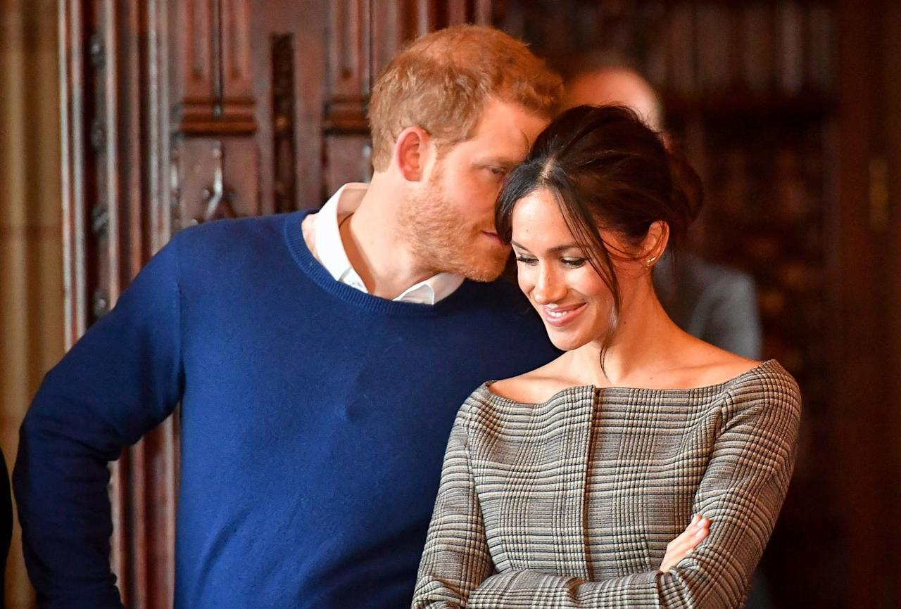 Harry and Meghan share a secret while visiting Cardiff Castle.