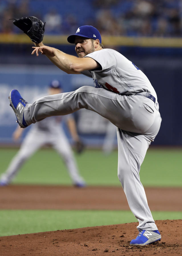 Los Angeles Dodgers starting pitcher Rich Hill follows through on a delivery to a Tampa Bay Rays batter during the first inning of a baseball game Wednesday, May 22, 2019, in St. Petersburg, Fla. (AP Photo/Chris O'Meara)