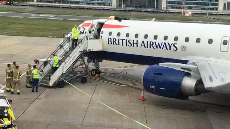 Paralympian James Brown lying top of a British Airways plane at City Airport, London (Extinction Rebellion/PA) (PA Media)