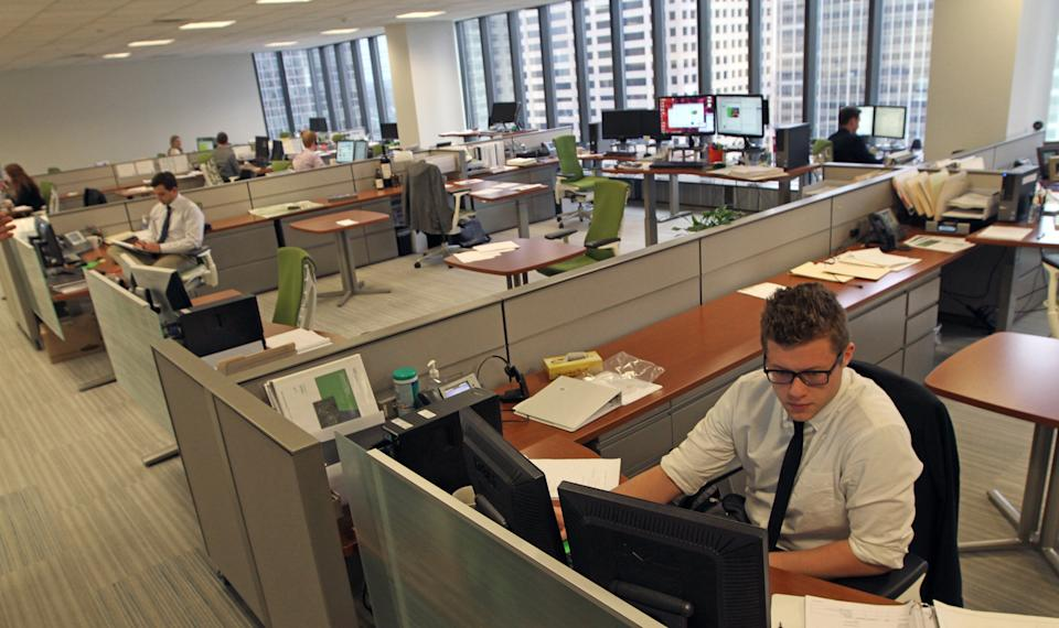 Doubling the size of individual working spaces could cost UK offices an extra £5,450 per person. every year. (MCT/SIPA USA/PA Images)