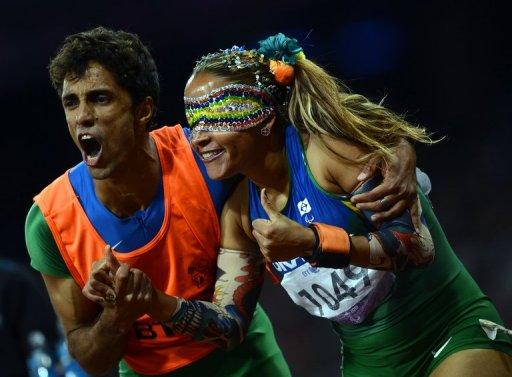 Brazil's Terezinha Guilhermina (right) and her guide Guilherme Soares de Santana celebrate after winning the women's 100m T11 final at the London 2012 Paralympic Games on September 5. Spurred on by Icelandic songstress Bjork, crowds at the London 2012 Paralympics are keeping a lid on their excitement for blind sports that need to be played in silence