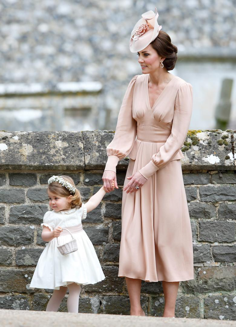 <p>For sister Pippa Middleton's wedding to James Matthews, the Duchess of Cambridge further cemented her style status in a dusty pink Alexander McQueen dress (estimated to have cost £2,000). To accessorise the bespoke look, she wore matching Gianvito Rossi shoes, £7,500 Kiki McDonough earrings and a Jane Taylor headpiece (rumoured to weigh in at £1,000). <em>[Photo: Getty]</em> </p>
