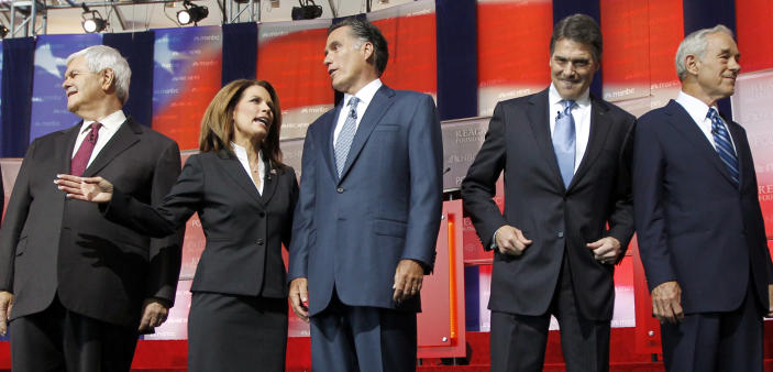 Republican presidential candidates, from left, former House Speaker Newt Gingrich, Rep. Michele Bachmann, R-Minn., former Massachusetts Gov. Mitt Romney, Texas Gov. Rick Perry, and Rep. Ron Paul, R-Texas., stand together before a Republican presidential candidate debate at the Reagan Library Wednesday, Sept. 7, 2011, in Simi Valley, Calif.