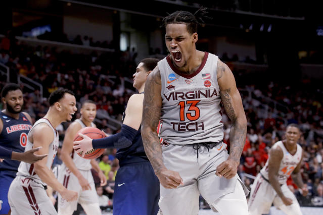 Virginia Tech guard Ahmed Hill celebrates after scoring against Liberty during the second half of a second-round game in the NCAA men's college basketball tournament Sunday, March 24, 2019, in San Jose, Calif. (AP Photo/Jeff Chiu)