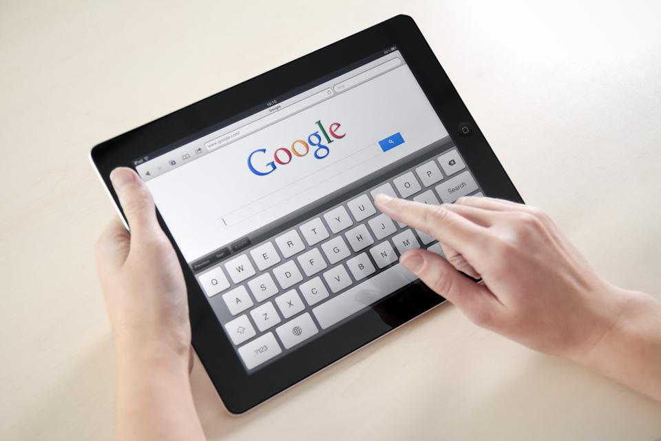 'Kiev, Ukraine - December 03, 2011: Woman hands holding and touching on Apple iPad2 with Google search web page on a screen. This second generation Apple iPad2 is designed and development by Apple inc. and launched in march 2011.'
