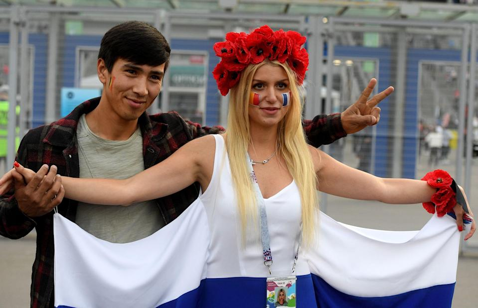 <p>Football fans arrive at the Saint Petersburg Stadium prior to the Russia 2018 World Cup semi-final football match between France and Belgium in Saint Petersburg on July 10, 2018. (Photo by OLGA MALTSEVA / AFP) </p>
