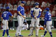 Toronto Blue Jays manager Charlie Montoyo (25) comes to the mound to relieve Jacob Waguespack, center left, during the sixth inning of a baseball game against the Boston Red Sox, Friday, Aug. 7, 2020, in Boston. (AP Photo/Michael Dwyer)