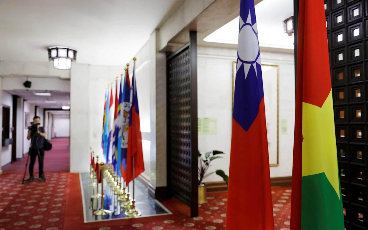 Flags of Taiwan (2nd-R) and Burkina Faso (R) are seen inside the Taiwan's Ministry of Foreign Affairs in Taipei - REUTERS