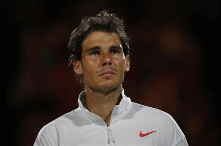 Rafael Nadal of Spain cries after being defeated in the men's singles final match against Stanislas Wawrinka of Switzerland at the Australian Open 2014 tennis tournament in Melbourne January 26, 2014. REUTERS/Jason Reed