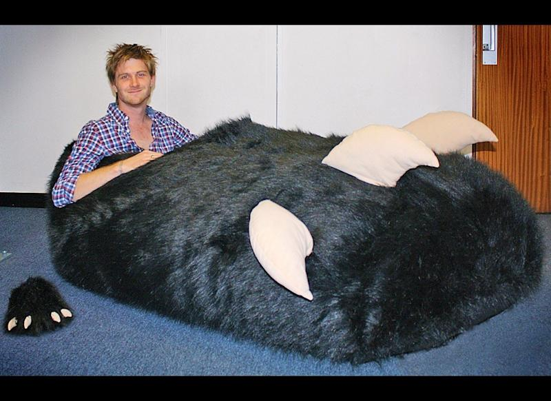 A man who ordered a special slipper to fit his oversized foot was sent a size 1,450 - after manufacturers failed to spot a decimal point in his order. Tom Boddingham, 27, has a size 13 right foot while his left is slightly bigger and measures a size 14-and-a-half. But when he ordered his custom-fit slipper manufacturers in China misread size 14.5 and accidently made a whopping 7ft long size 1,450
