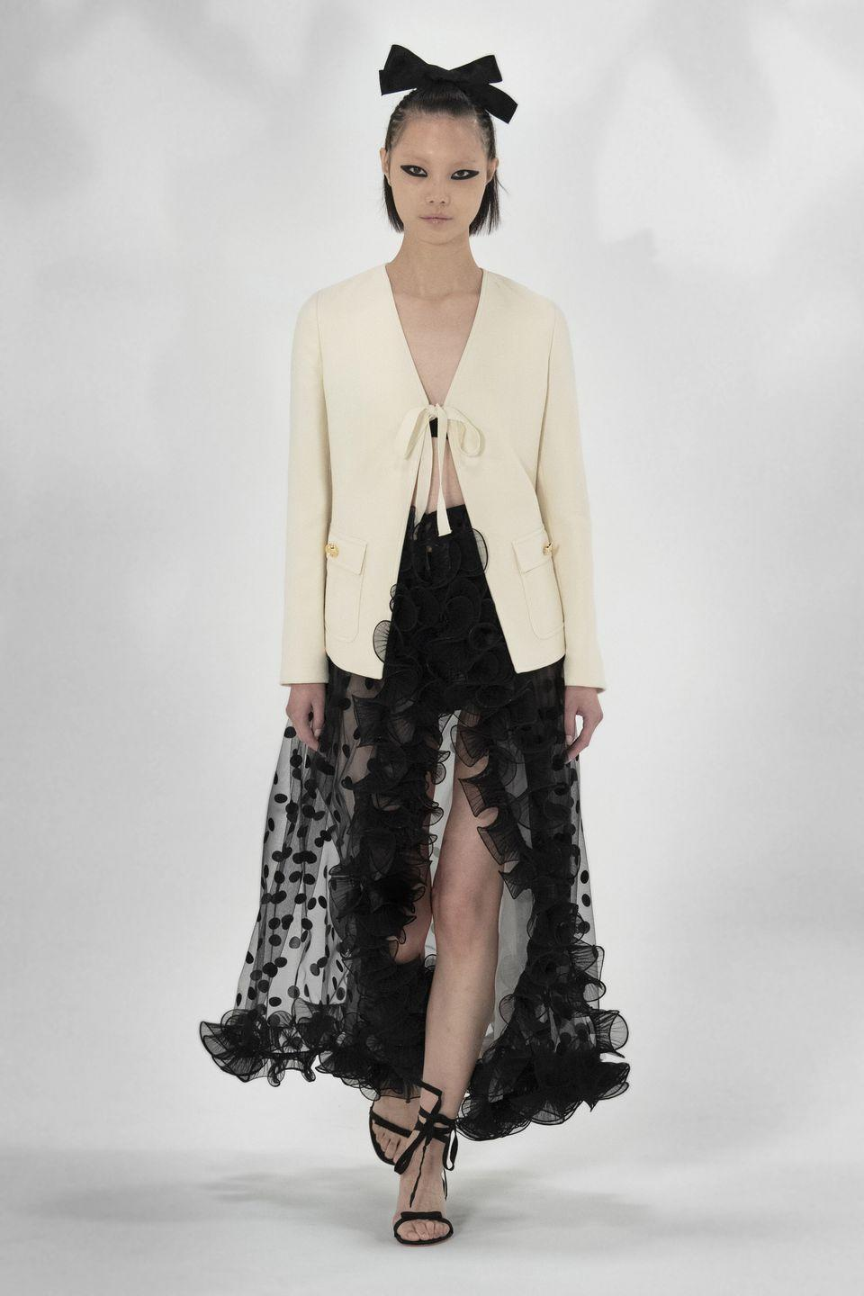 "<p>For spring/summer 2021, Giambattista Valli headed home to Italy for inspiration, basing the new-season collection on the ""blooming nature of the Mediterranean"". The collection – which featured sorbet shades, tropical prints, floaty holiday dresses and a dash of the designer's trademark tulle – was presented digitally via a video (<a href=""https://www.instagram.com/p/CF9eOkOBwkc/"" rel=""nofollow noopener"" target=""_blank"" data-ylk=""slk:which you can watch here"" class=""link rapid-noclick-resp"">which you can watch here</a>), as well as through a catwalk show that took place to no audience.</p>"
