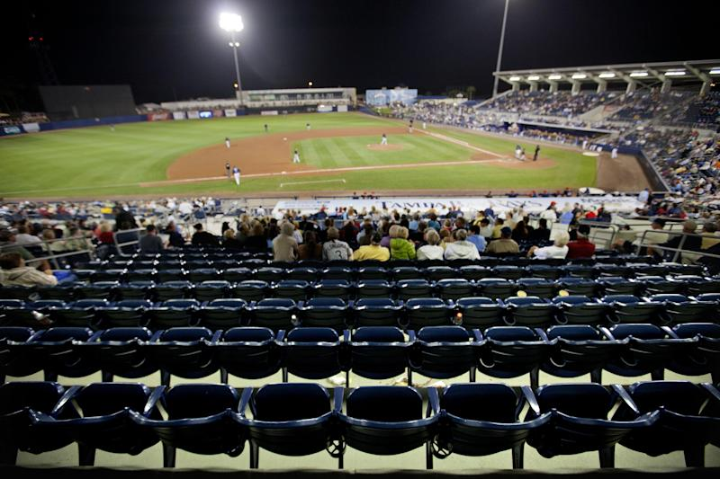 In this March 11, 2013 photo, seats sit vacant during a spring training exhibition baseball game between the Minnesota Twins and the Tampa Bay Rays in Port Charlotte, Fla. Spring training attendance is off and several things are to blame, aside from pricey tickets _ early start, cold weather and lineups depleted by injured stars and players dispatched to the World Baseball Classic. (AP Photo/David Goldman)