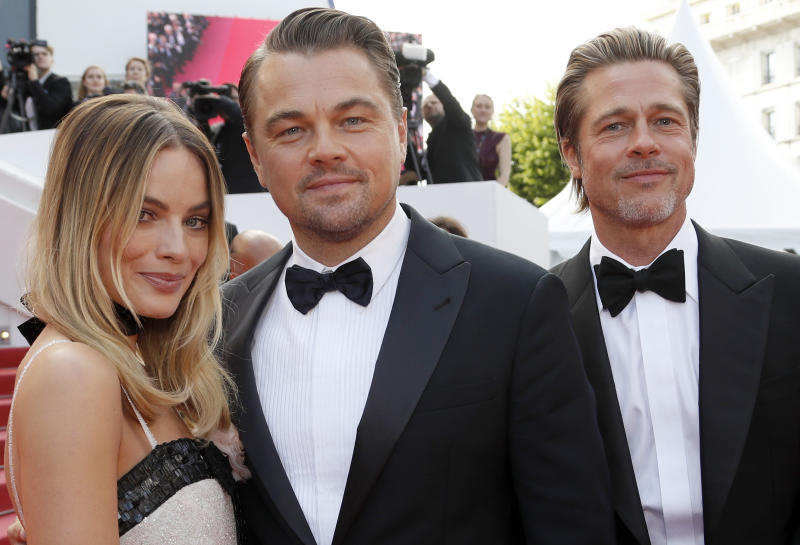 "72nd Cannes Film Festival - Screening of the film ""Once Upon a Time in Hollywood"" in competition - Red Carpet Arrivals - Cannes, France, May 21, 2019. Cast members Brad Pitt, Margot Robbie and Leonardo DiCaprio pose. REUTERS/Eric Gaillard"