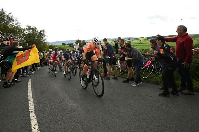Crowds lined the road as the women climbed Norwood Edge (AFP Photo/BEN STANSALL)