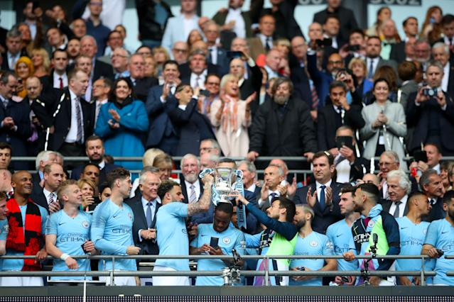 David Silva joins the FA Cup trophy celebrations as Man City complete the domestic treble (Photo by Nick Potts/PA Images via Getty Images)