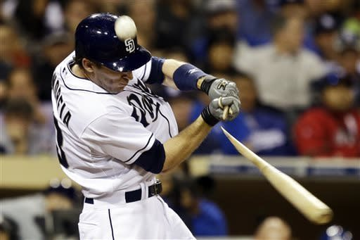 San Diego Padres' Chris Denorfia breaks his bat as the ball flies foul during the fourth inning of a baseball game against the Los Angeles Dodgers in San Diego, Wednesday, April 10, 2013. (AP Photo/Lenny Ignelzi)