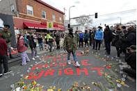 <p>A crowd gathers at a memorial for Daunte Wright while waiting for the verdict to be read. Wright was shot and killed by a police officer in April just 10 miles from where Derek Chauvin murdered George Floyd. </p>