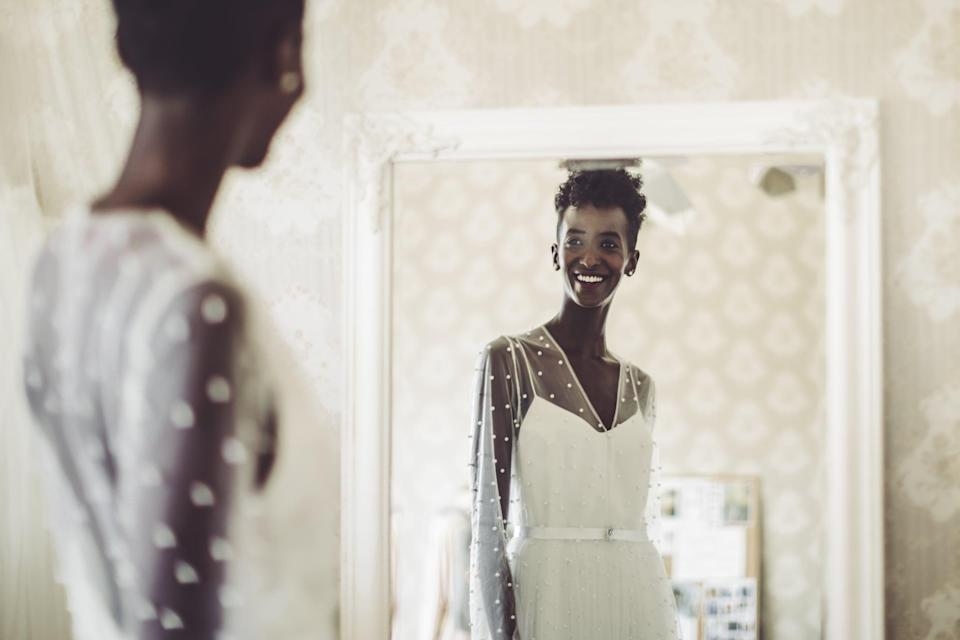 """<p>This one is of utmost importance. Make sure your photographer is in the room, positioned so as to be out of the photo (but with a full view of the mirror) the first time you look at yourself in your <a class=""""link rapid-noclick-resp"""" href=""""https://www.popsugar.co.uk/tag/Wedding"""" rel=""""nofollow noopener"""" target=""""_blank"""" data-ylk=""""slk:wedding"""">wedding</a> dress on your big day. </p>"""