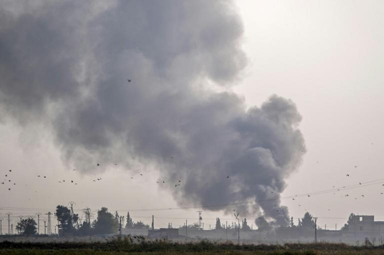 Smoke rises from the Syrian town of Tal Abyad after Turkish bombings Wednesday as Ankara opened up an assault on the mostly Kurdish region