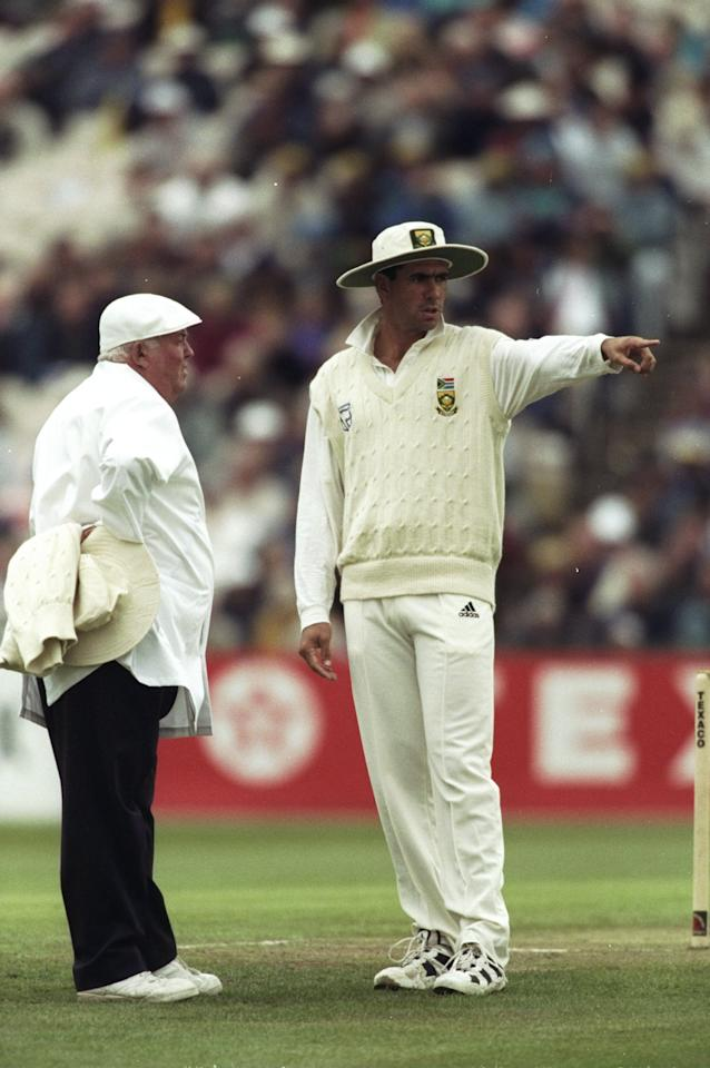 23 May 1998:  Hansie Cronje of South Africa discusses a point with Umpire David Shepherd during the second Texaco Trophy One Day International against England at Old Trafford in Manchester, England. South Africa won the match by 32 runs. \ Mandatory Credit: Adrian  Murrell/Allsport