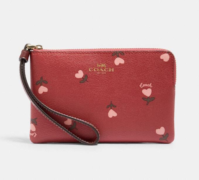 Corner Zip Wristlet With Heart Floral Print. Image via Coach Outlet.