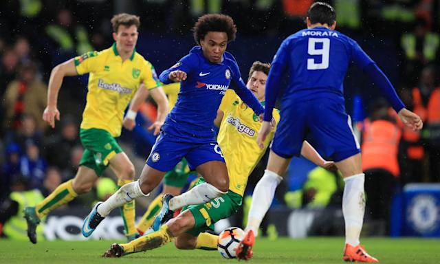 Willian goes down under a challenge from Norwich's Timm Klose.