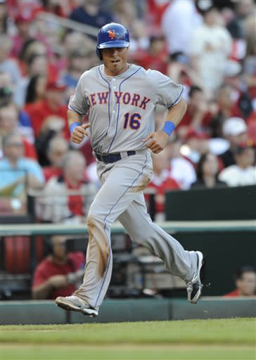 New York Mets' Rick Ankiel (16) runs home on a double by Mets' Daniel Murphy against the St. Louis Cardinals' in the second inning in a baseball game Monday, May 13, 2013, at Busch Stadium in St. Louis. (AP Photo/Bill Boyce)