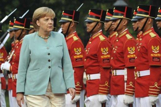 """Merkel said she was """"deeply convinced""""  Europe must set up an agreement if """"it wants to be able to compete"""""""