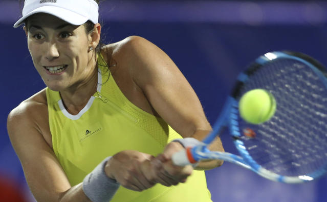 Garbine Muguruza of Spain returns the ball to Daria Kasatkina of Russia during a semi final match of the Dubai Duty Free Tennis Championship in Dubai, United Arab Emirates, Friday, Feb. 23, 2018. (AP Photo/Kamran Jebreili)
