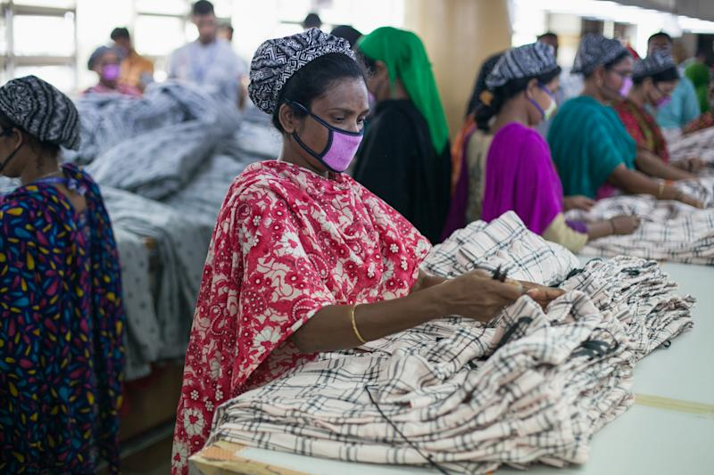 Bangladeshi workers work at a garment factory in Savar outskirts of Dhaka on February 6, 2020. The garment sector has provided employment opportunities to women from the rural areas that previously did not have any opportunity to be part of the formal workforce. This has given women the chance to be financially independent and have a voice in the family because now they contribute financially. However, women workers face problems. Most women come from low income families. Low wage of women workers and their compliance have enabled the industry to compete with the world market. The textile and clothing industries provide the single source of growth in Bangladesh's rapidly developing economy. Exports of textiles and garments are the principal source of foreign exchange earnings. Bangladesh is the world's second-largest apparel exporter of western (fast) fashion brands. Sixty percent of the export contracts of western brands are with European buyers and about forty percent with American buyers. (Photo by Mehedi Hasan/NurPhoto via Getty Images)