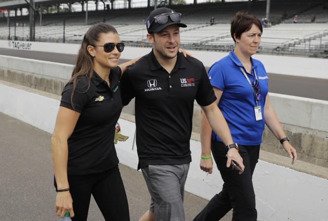 Danica Patrick and Marco Andretti walk to the drivers meeting for the Indianapolis 500 auto race at Indianapolis Motor Speedway, in Indianapolis Saturday, May 26, 2018. (AP Photo/Darron Cummings)