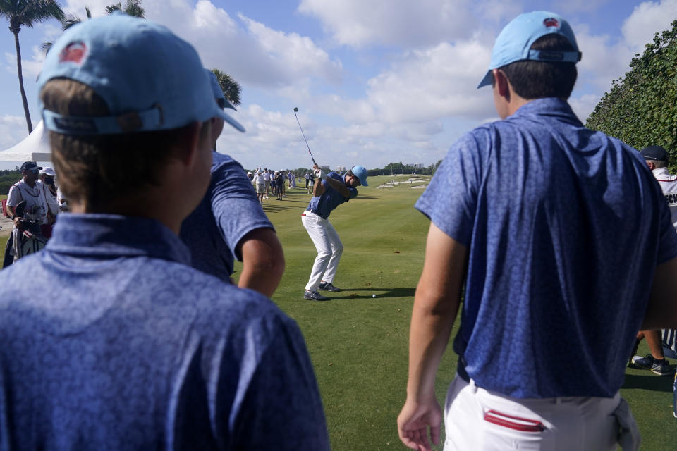 Members of the USA team watch as Stewart Hagestad tees off during a practice day for the Walker Cup golf tournament at Seminole Golf Club in Juno Beach, Fla., Friday, May 7, 2021. (AP Photo/Gerald Herbert)