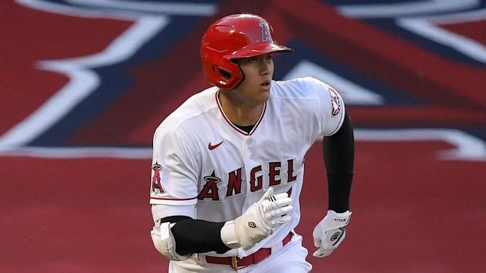 Los Angeles Angels' Shohei Ohtani, of Japan, runs to first as he pops out during the first inning of a baseball game against the Seattle Mariners Wednesday, July 29, 2020, in Anaheim, Calif. (AP Photo/Mark J. Terrill)