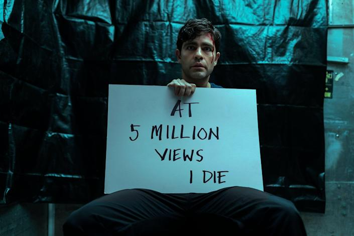 An abducted Nick Brewer (Adrian Grenier) is at the center of a bizarre viral video.