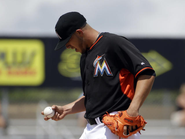 Miami Marlins starting pitcher Jose Fernandez looks at the ball during the third inning of an exhibition spring training baseball game against the St. Louis Cardinals, Tuesday, March 25, 2014, in Jupiter, Fla. (AP Photo/David Goldman)