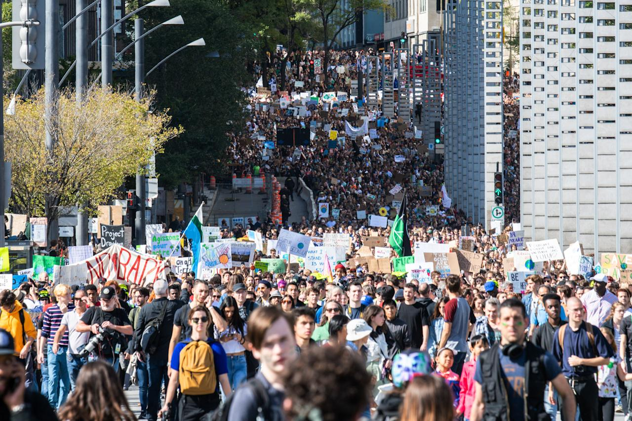 Thousands of protesters march on the streets during the global climate strike in Montreal, Canada on September 27, 2019. - Teen activist Greta Thunberg called on Canadian Prime Minister Justin Trudeau and other world leaders Friday (Photo credit should read MARTIN OUELLET-DIOTTE/AFP/Getty Images)