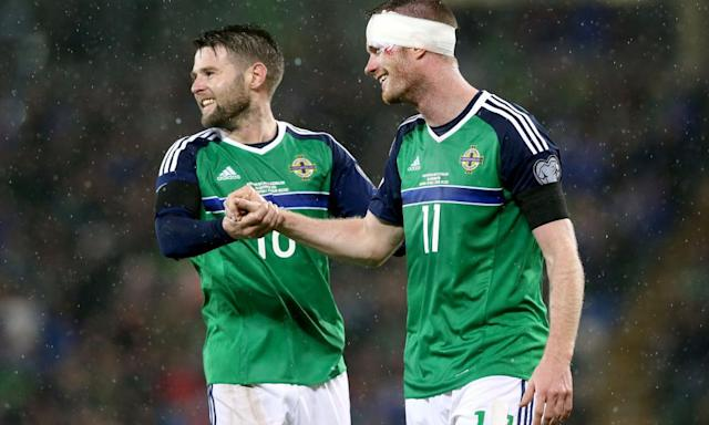 """<span class=""""element-image__caption"""">Oliver Norwood and Chris Brunt celebrate during Northern Ireland's win over Azerbaijan in November.</span> <span class=""""element-image__credit"""">Photograph: Brian Lawless/PA</span>"""